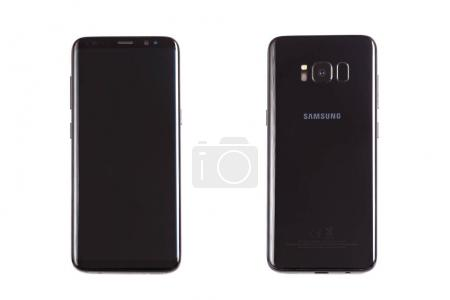 GDANSK, POLAND - NOVEMBER 23, 2017: Brand new black Samsung Galaxy S8. Front and back side isolate on white background.