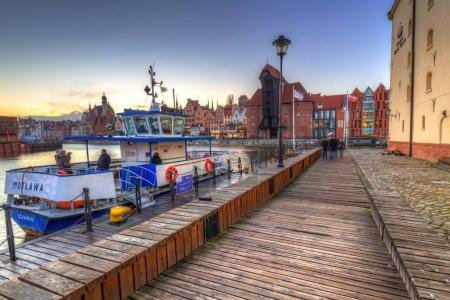 GDANSK, POLAND - DECEMBER 8, 2017: Winter sunset at Motlawa river and marina in Gdansk, Poland. Gdansk is the historical capital of Polish Pomerania.