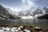 Beautiful winter at Eye of the Sea lake in in Tatra mountains, Poland