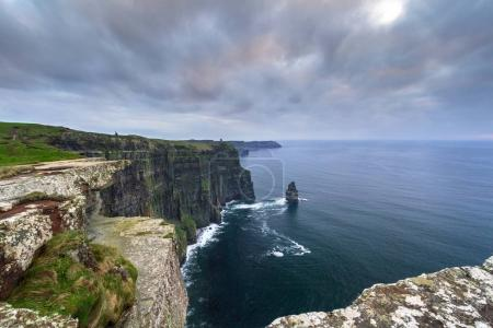 Cliffs of Moher in Ireland at cloudy day, Co. Clare