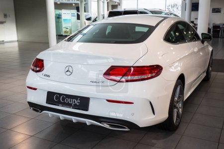 GDANSK, POLAND - FEBRUARY 13, 2018: New Mercedes C coupe in the car showroom of Gdansk, Poland. Mercedes-Benz is German luxury  automobile manufacturer located in Stuttgart.
