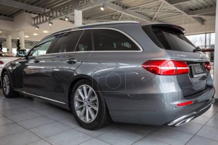 GDANSK, POLAND - FEBRUARY 13, 2018: Mercedes E class limousine in the car showroom of Gdansk, Poland. Mercedes-Benz is German luxury  automobile manufacturer located in Stuttgart.