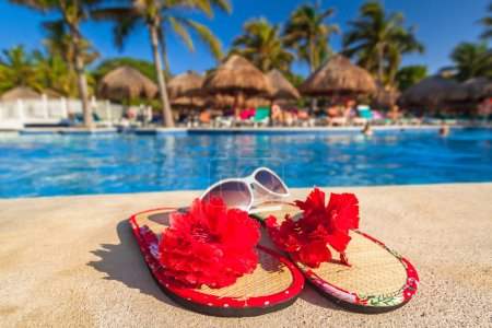 Photo for Holiday accessories at swimming pool - Royalty Free Image