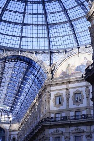 Glass dome of Galleria Vittorio Emanuele II shopping gallery. Mi