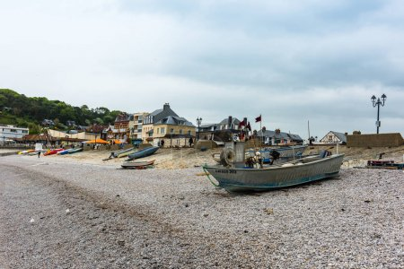 View of the beach and fishing boats in Etretat