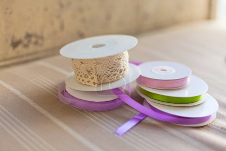 Rolls with pastel ribbons and laces