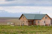 Wooden cottage in Iceland landscape