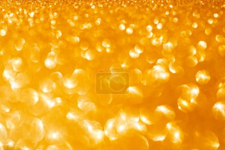 Photo for Christmas and New Year holiday Golden Glitter Shimmering festive abstract texture background with bokeh defocused lights - Royalty Free Image