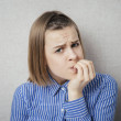 Offended young girl with finger in mouth...