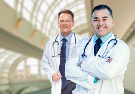 Handsome Male Doctors or Nurses Inside Hospital Building