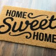 Home Sweet Home Welcome Mat On Wood Floor....