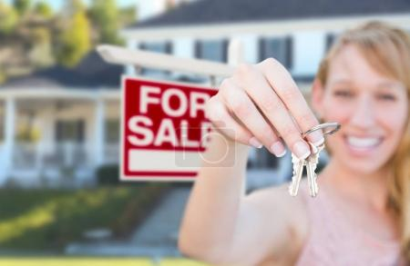 Excited Woman Holding House Keys and For Sale Real Estate Sign i