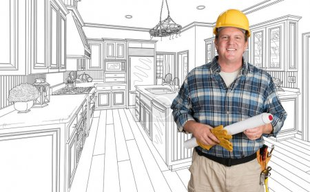 Photo for Male Contractor With House Plans Wearing Hard Hat In Front of Custom Kitchen Drawing - Royalty Free Image