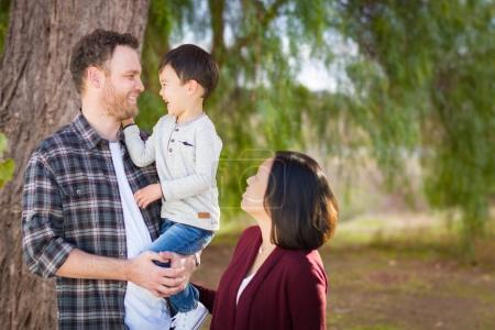 Young Mixed Race Caucasian and Chinese Family Portrait Outdoors.