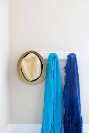 Wall in House with Hat and Scarfs Hanging on Coat Rack Hooks Abstract.