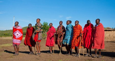 Photo for Unidentified Maasai men on Oct 15, 2012 in the Maasai Mara, Kenya. Maasai are a Nilotic ethnic group of semi-nomadic people located in Kenya and northern Tanzania. - Royalty Free Image