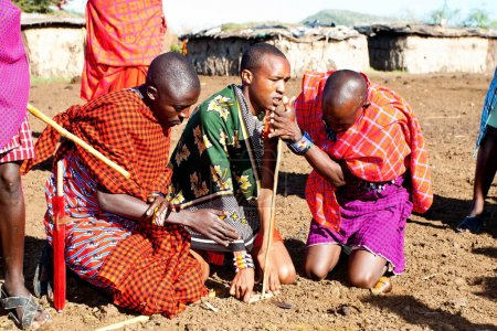 Unidentified Maasai men on Oct 15, 2012 in the Maasai Mara, Kenya. Maasai are a Nilotic ethnic group of semi-nomadic people located in Kenya and northern Tanzania.
