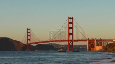 Photo for The Golden Gate Bridge as seen from Baker Beach at sunset, San Francisco, California, USA - Royalty Free Image