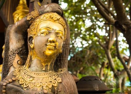Golden wooden statue in Lamphun