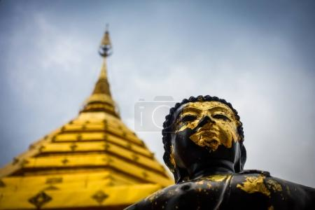 Black and gold statue of Buddha in Doi Suthep