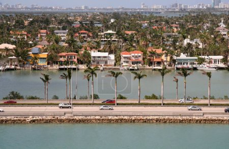 Photo for Miami Floriday Landscape with Roadway and Expensive Homes - Royalty Free Image