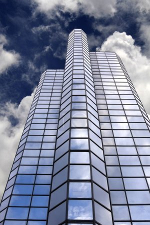 Office Building Skyscraper with Blue Sky Background