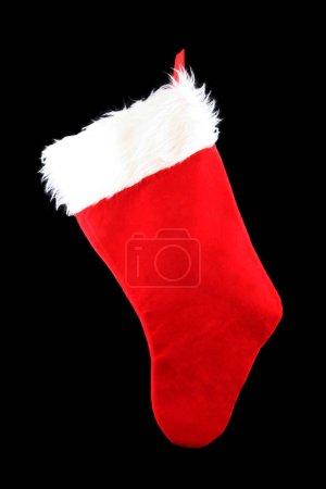 Hanging Christmas Stocking Isolated on a Black Background