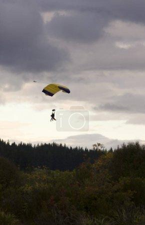 Paragliders Decending onto Ground