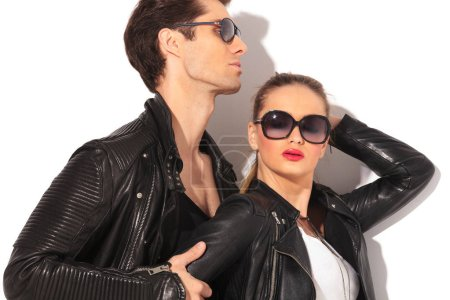 closeup of a young hot couple in leather jackets