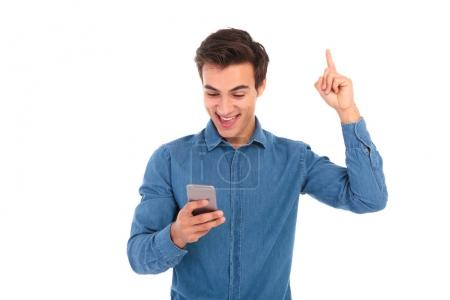 excited casual man reading good news on his smartphone