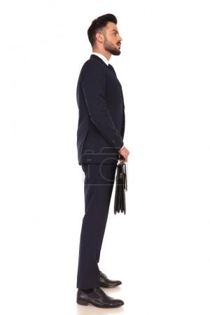 young business man holding a briefcase and standing in line