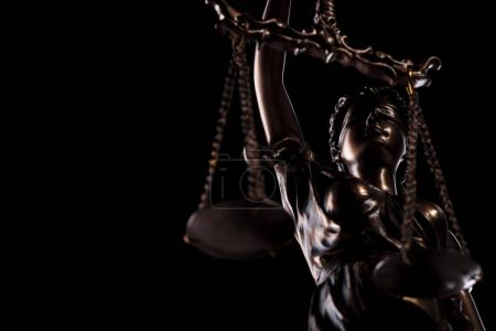 cut out image of the goddess of justice statue