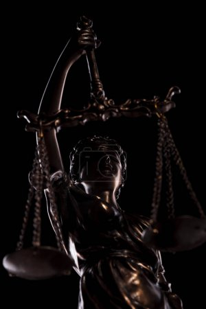 portrait of justice goddess holding her scale