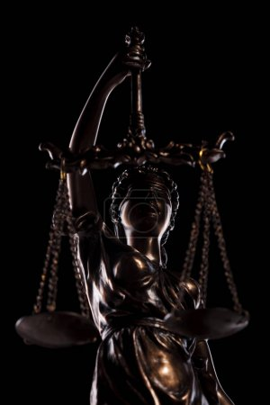 the blind goddess of justice holding the scales