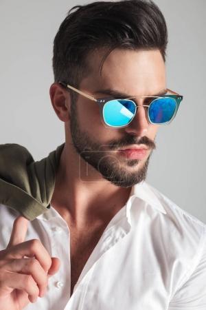side view closeup portrait of a  fashion man in sunglasses