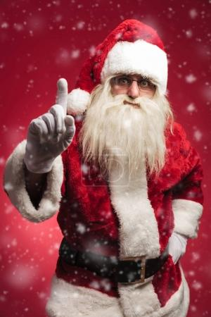 attention! santa claus is warning all the bad kids