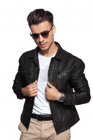 cool young fashion man pulling leather jacket's collar