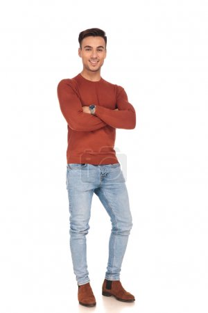 fit casual man smiling and standing with hands crossed
