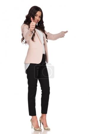 happy business woman presenting and making the ok sign