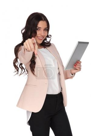 young beautiful  business woman holding tablet and points finger