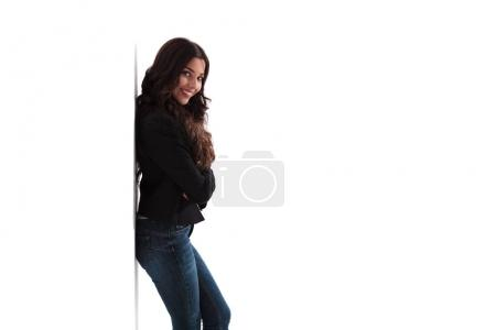 side view of a happy young woman with hands crossed