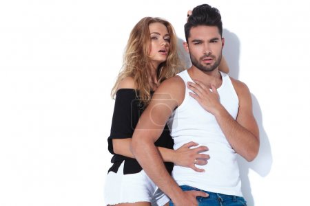 sexy woman pulling her boyfriend's hair and embraces him