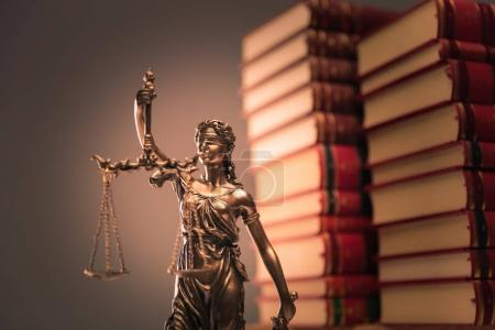 law books and justice statue