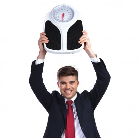 happy businessman succeeds in losing weight