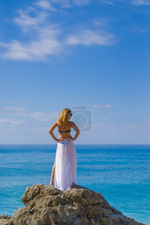woman relaxing on the beach in Greece