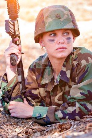 Military Woman with Gun