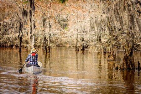 Photo for Man in kayak paddling on lake - Royalty Free Image
