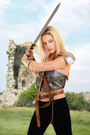 woman warrior with ruins in background