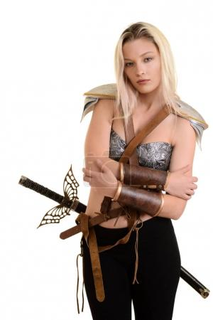 female warrior hugging herself