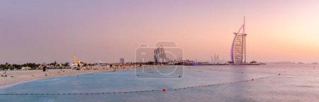 Panoramic view of Jumeirah Beach and Burj Al Arab hotel at sunset